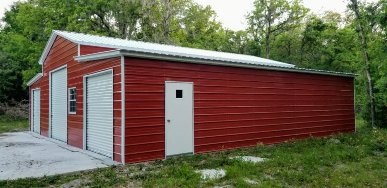 Red Barn used as for vehicle storage and lawn equipment