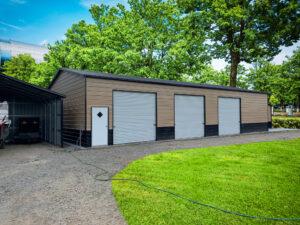 Car Garage with a walk-in door and roll-up doors